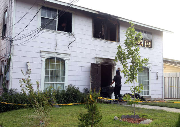 A fire broke out late Wednesday night August 15, 2012 at this residence on the 300 block of West Norwood. Three men with alleged mental disabilities died in the blaze and another person is in critical condition. The incident is currently being investigated. John Davenport/© 2012 San Antonio Express-News Photo: John Davenport, San Antonio Express-News / John Davenport/©San Antonio Exp
