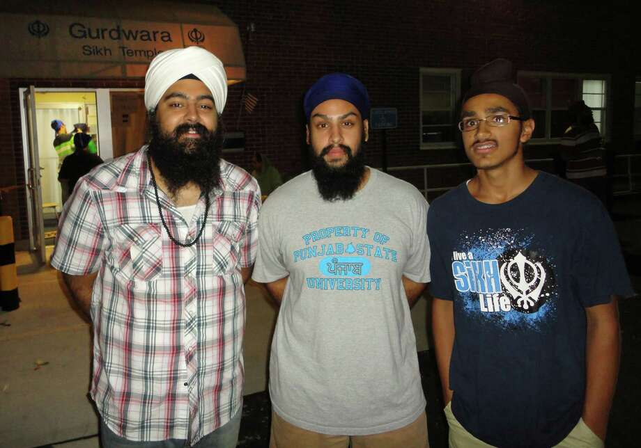 Jagmeet âÄúJeetoâÄù Sethi, 22, of Trumbull, an owner of Turban, Inc., with Deshmeth Singh of San Antonio, Texas, and Saihajdeep Singh, of Norwalk. Deshmeth Singh and Saihajdeep Singh are wearing Tishirts from Turban, Inc's clothing line. Photo: Meg Barone / Connecticut Post Freelance
