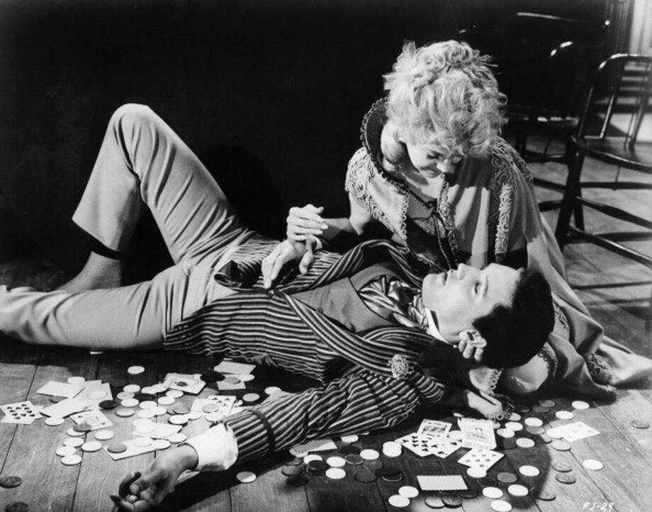 Elvis Presley is cradled by Donna Douglas on the floor in a scene from the film 'Frankie And Johnny', 1966. (Photo by United Artists/Getty Images) (Getty Images)