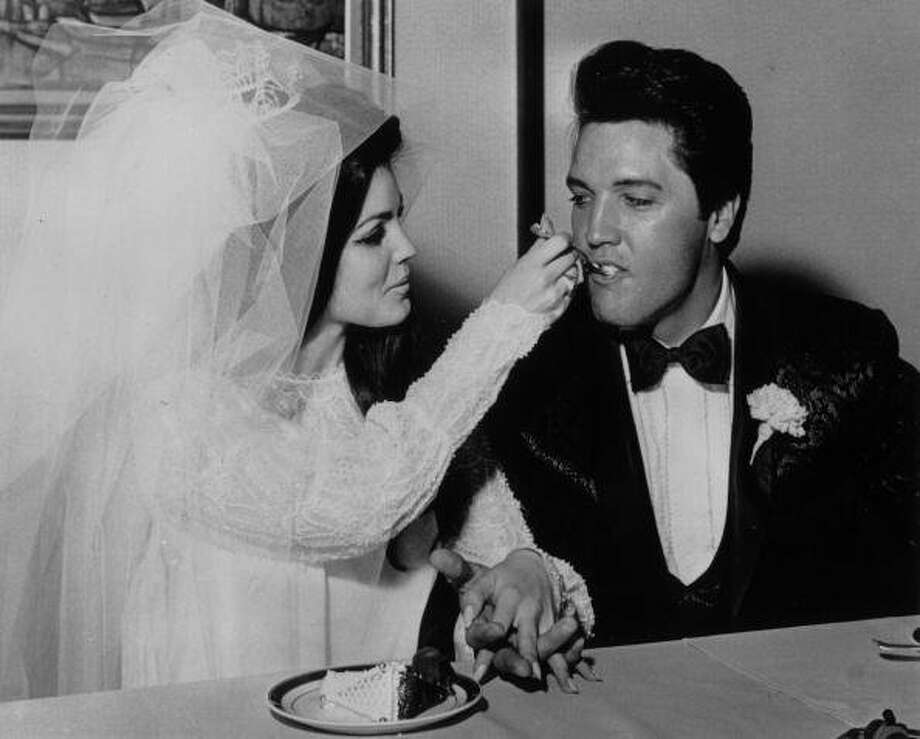 Elvis Presley  being fed a mouthful of wedding cake by his bride Priscilla Beaulieu at the Aladdin Hotel, Las Vegas.   (Photo by Keystone/Getty Images) (Getty Images)