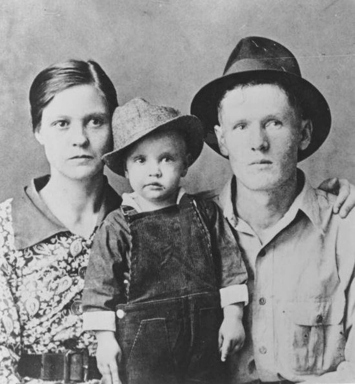 Rock and roll singer Elvis Presley poses for a family portrait with his parents Vernon Presley and Gladys Presley in 1937 in Tupelo, Mississippi. (Photo by Michael Ochs Archives/Getty Images)