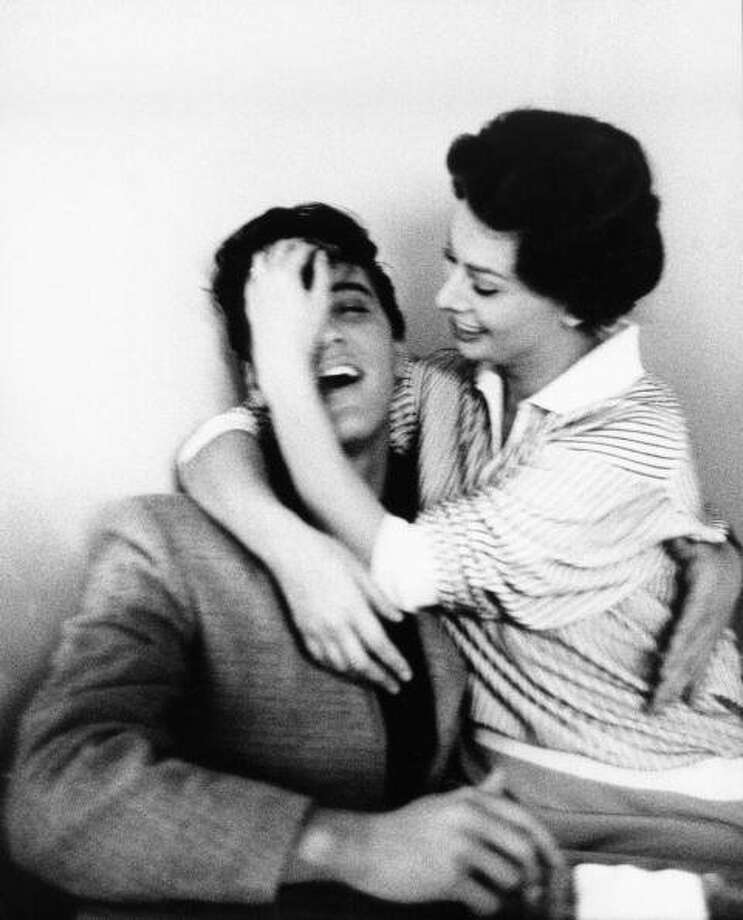 CIRCA 1958:  Photo of Sophia LOREN and Elvis PRESLEY; with Sophia Loren, posed  (Photo by Bob Willoughby/Redferns) (Redferns)