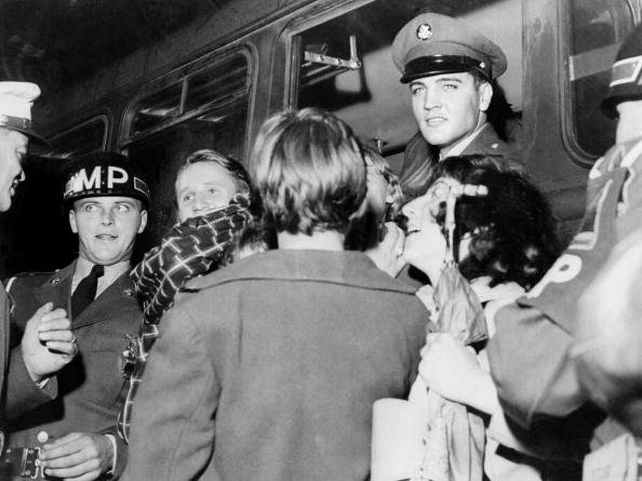 Picture taken in 1959 in Germany of US rock star Elvis Presley (C) cheered by fans upon his arrival at Friedberg, to do his military service. Elvis spent two years in Germany whilst in the US Army. (Photo STF/AFP/Getty Images) (AFP/Getty Images)