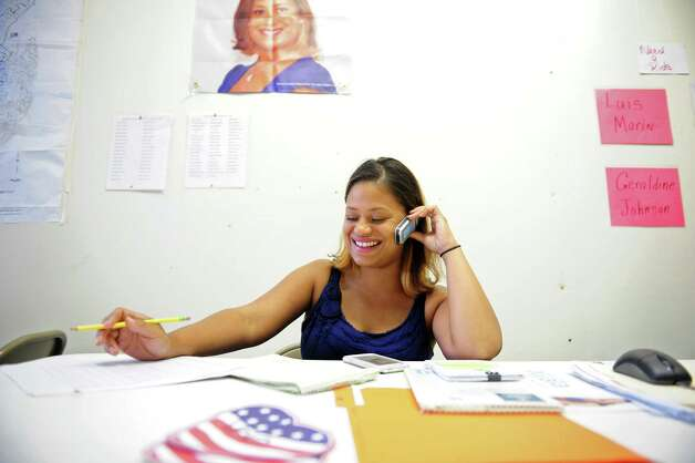 Christina Ayala, candidate for Connecticut's 128th State Assembly District, works the phones at her campaign headquarters on East Main Street in Bridgeport, Conn. Tuesday, August 7, 2012. Photo: Autumn Driscoll / Connecticut Post