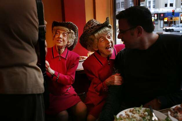 Parked in their usual window seat at Uncle Vito's pizza shop on Nob Hill, San Francisco's famous twins, Marion and Vivian Brown welcome adoring fans at their dinner table. Photo: Mike Kepka, The Chronicle