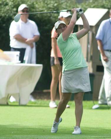 Erica Barnes hits a tee shot during final round play in the Connecticut State Women's Amateur Golf Championship Thursday at Ridgewood Country Club in Danbury. Photo: Barry Horn
