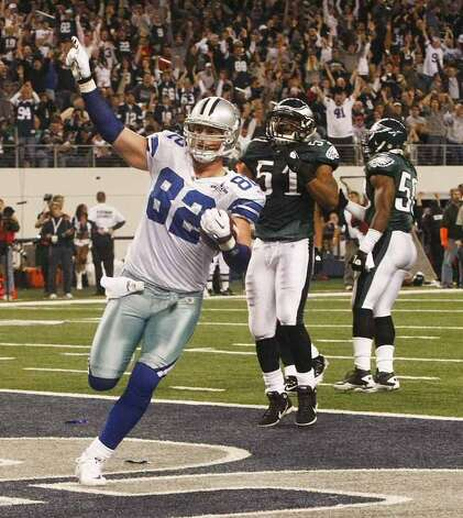 Dallas Cowboys tight end Jason Witten (82) scores a touchdown during the second half followed by Philadelphia Eagles defensive end Antwan Barnes (51) during the second half of an NFL football game against the Philadelphia Eagles, Sunday, Dec. 12, 2010, in Arlington, Texas. (AP Photo/Waco Tribune-Herald/Jose Yau) (Jose Yau / AP)