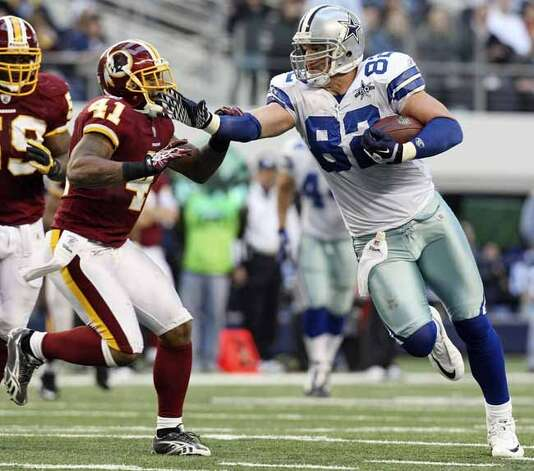 Dallas Cowboys' Jason Witten looks for room around Washington Redskins' Kareem Moore during second half action Sunday Dec. 19, 2010 at Cowboys Stadium in Arlington, Tx. The Cowboys won 33-30. (PHOTO BY EDWARD A. ORNELAS/eaornelas@express-news.net) (EDWARD A. ORNELAS / SAN ANTONIO EXPRESS-NEWS)