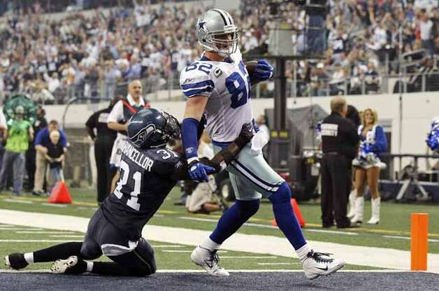 FOR SPORTS - Dallas Cowboys' Jason Witten scores a touchdown around Seattle Seahawks' Kam Chancellor during second half action Sunday Nov. 6, 2011 at Cowboys Stadium in Arlington, TX. The Cowboys won 23-13. (PHOTO BY EDWARD A. ORNELAS/eaornelas@express-news.net) (EDWARD A. ORNELAS / SAN ANTONIO EXPRESS-NEWS)