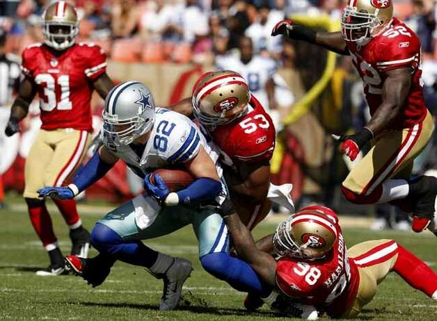 The 49er defense was all over Jason Witten after a second half catch. San Francisco 49ers lose to the Dallas Cowboys in overtime 27-24 at Candlestick Park Sunday September 18, 2011. (Brant Ward / The Chronicle)