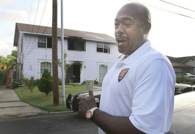 San Antonio Fire Chief Charles Hood speaks Thursday morning about a fire that broke out late Wednesday night on the 300 block of West Norwood that resulted in the deaths of three men. Another person is in critical condition. (Thursday August 16, 2012) John Davenport/© 2012 San Antonio Express-News Photo: John Davenport, San Antonio Express-News / John Davenport/©San Antonio Exp
