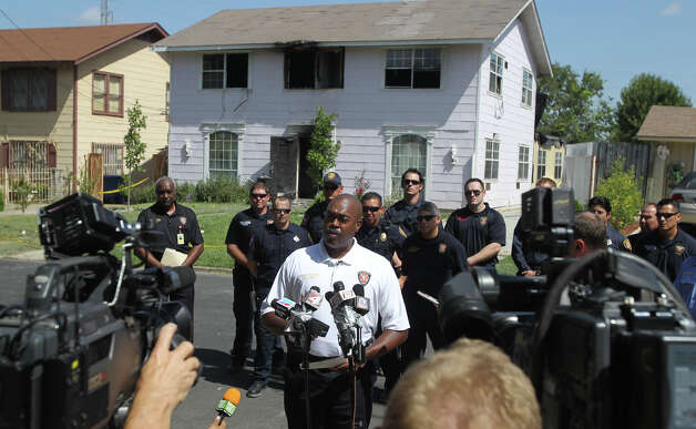San Antonio Fire Chief Charles Hood speaks Thursday about a fire that broke out late Wednesday night on the 300 block of West Norwood that resulted in the deaths of three men. Another person is in critical condition. (Thursday August 16, 2012) John Davenport/© 2012 San Antonio Express-News Photo: John Davenport, San Antonio Express-News / John Davenport/©San Antonio Exp