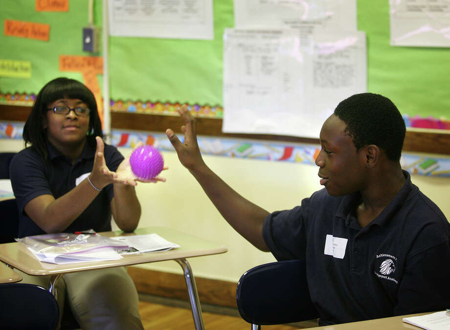 """Ebony Jones, left, is passed the ball by Jevoun Rodney in an activity called """"categories"""" in their eighth grade class on the first day of the new school year at Achievement First Bridgeport Academy on Thursday, August 16, 2012. Photo: Brian A. Pounds / Connecticut Post"""