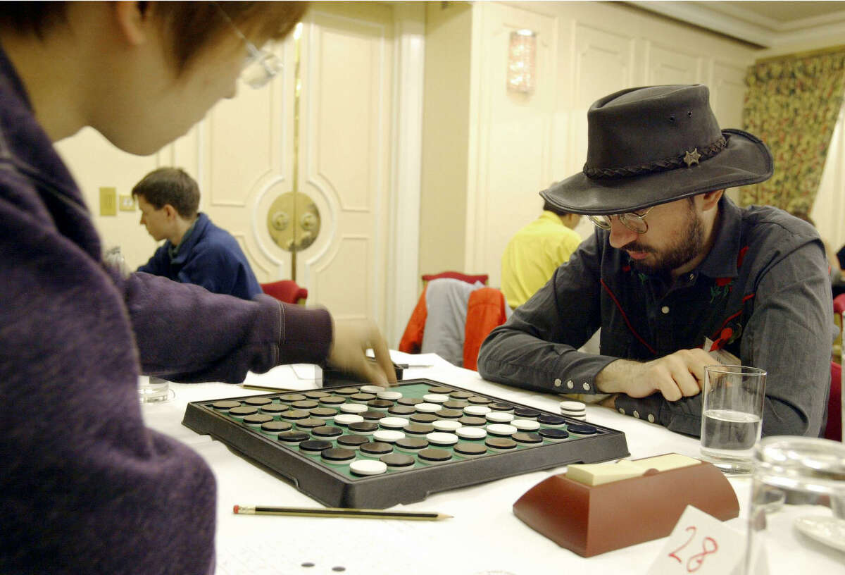 Sticking with London, here's British competitor Ben Pridmore studying his score sheet as his opponent makes his move in the World Othello Championships on November 14, 2004.
