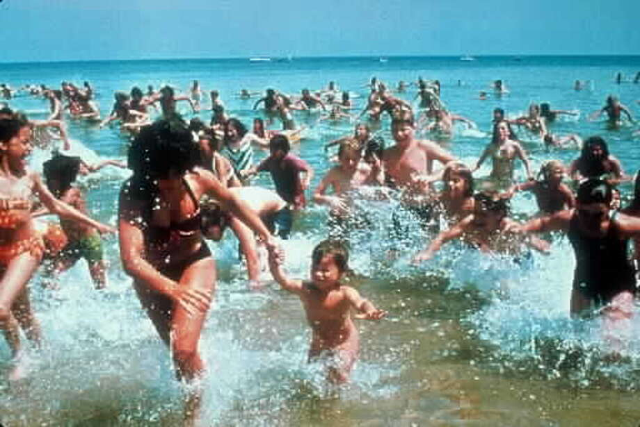 "1975: Fleeing sharks in ""Jaws"" or flocking to the theater to see ""Jaws""? You decide."
