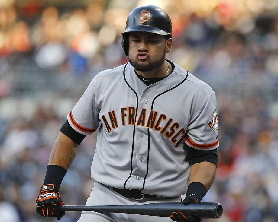 FILE - This June 5, 2012 file photo shows San Francisco Giants' Melky Cabrera reacting after striking out during the first inning of a baseball game against the San Diego Padres in San Diego. Cabrera has been suspended for 50 games without pay after testing positive for testosterone. The commissioner's office says the suspension is effective immediately. Major League Baseball said on Wednesday, Aug. 15, 2012,  that Cabrera tested positive for the banned performance-enhancing substance, which violates MLB's joint drug prevention and treatment program. (AP Photo/Lenny Ignelzi, File) Photo: Lenny Ignelzi, Associated Press