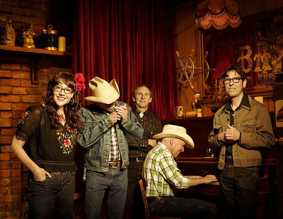 "Country band Red Meat is made up of Jill Olson (left), Dave ""Smelley"" Kelley, Les James, Scott Young and Michael Montalto. Photo: Bryan Davis"