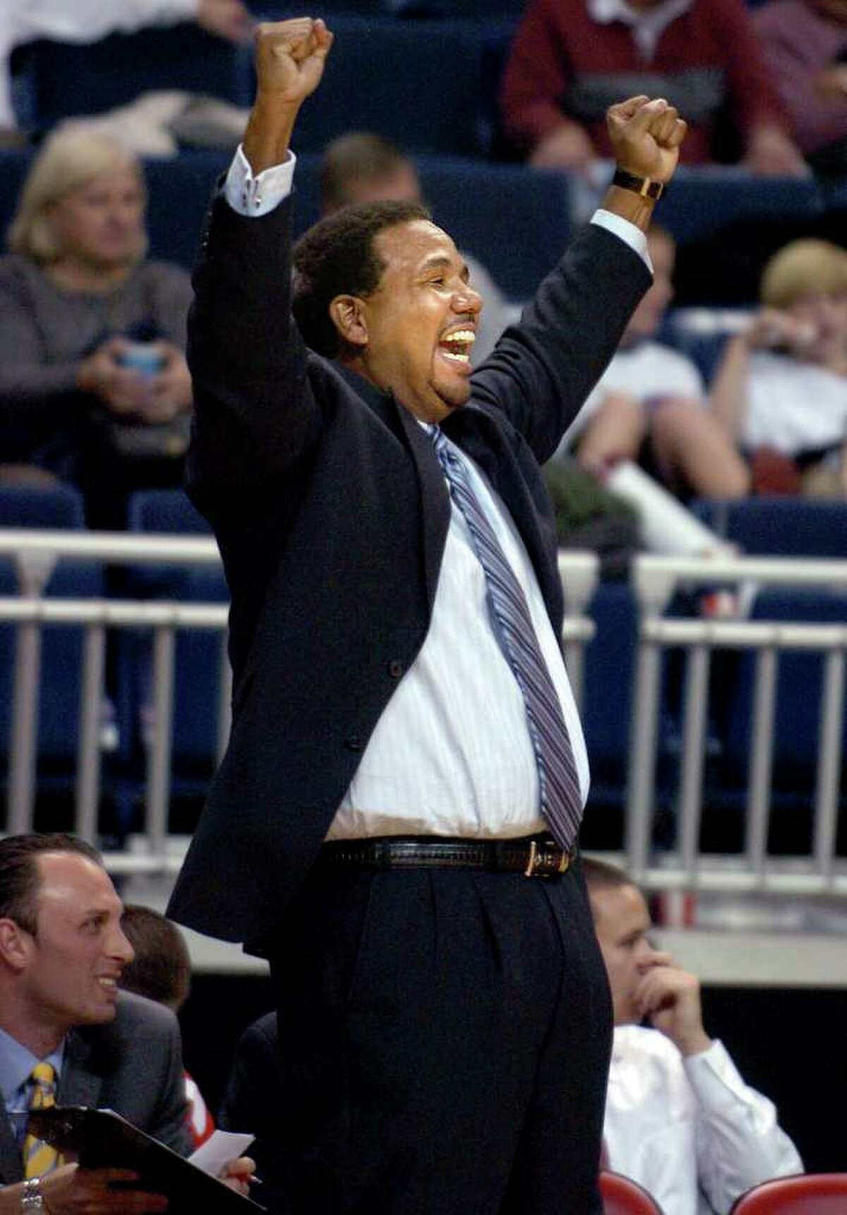 Fairfield University coach Ed Cooley celebrates a call in the second half of Thursday night's game against Marist at the Arena at Harbor Yard.