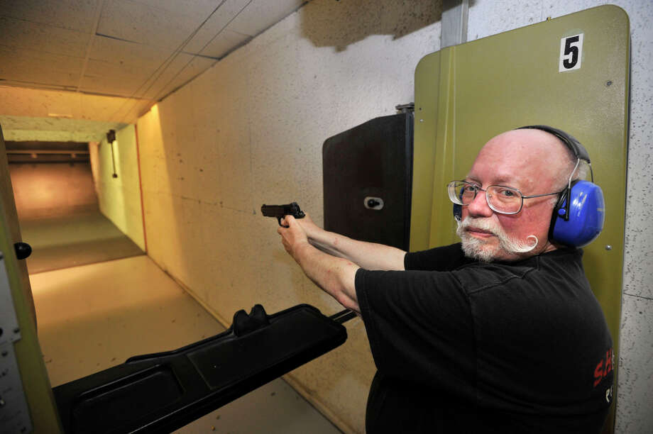 Newtown resident Dick Giannettino, co-owner of Shooters Indoor Pistol Range in New Milford, is against the firearms discharge ordinance that Newtown is proposing. Photographed on Thursday, Aug. 16, 2012. Photo: Jason Rearick / The News-Times