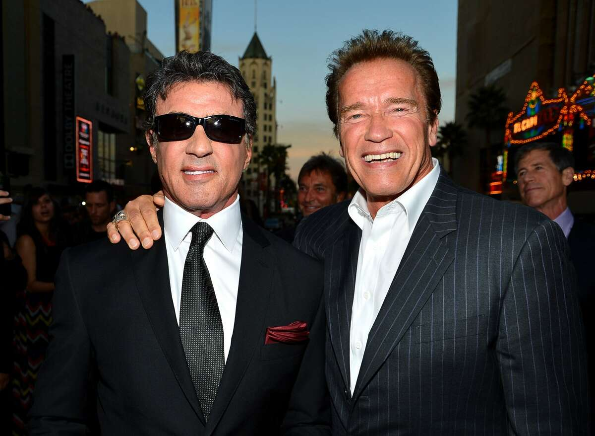 """Actor/writer/director Sylvester Stallone and actor Arnold Schwarzenegger arrive at Lionsgate Films'""""The Expendables 2"""" premiere on August 15, 2012 in Hollywood, California. (Frazer Harrison / Getty Images)"""