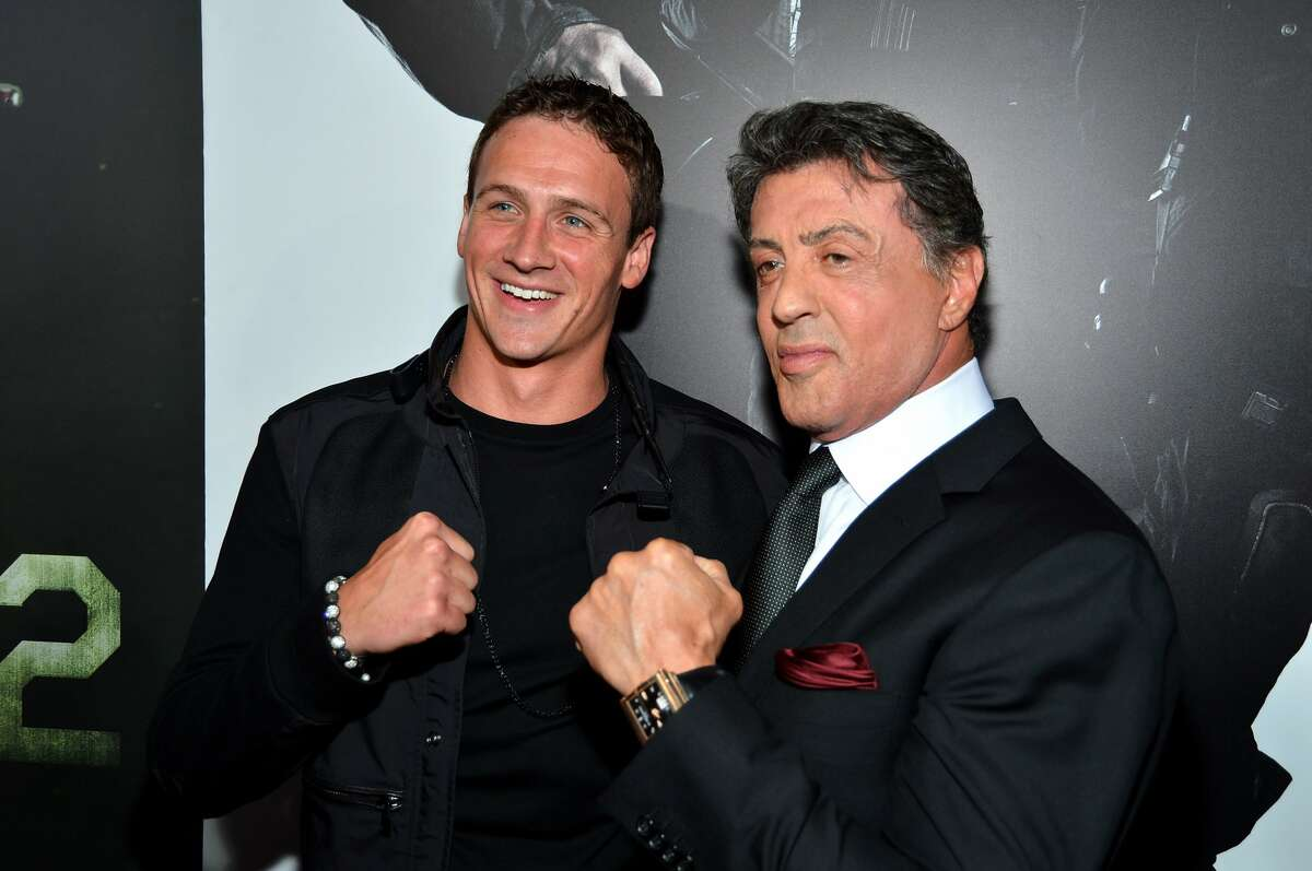 """Olympic swimmer Ryan Lochte and actor/writer/director Sylvester Stallone arrives at Lionsgate Films'""""The Expendables 2"""" premiere on August 15, 2012 in Hollywood, California. (Frazer Harrison / Getty Images)"""