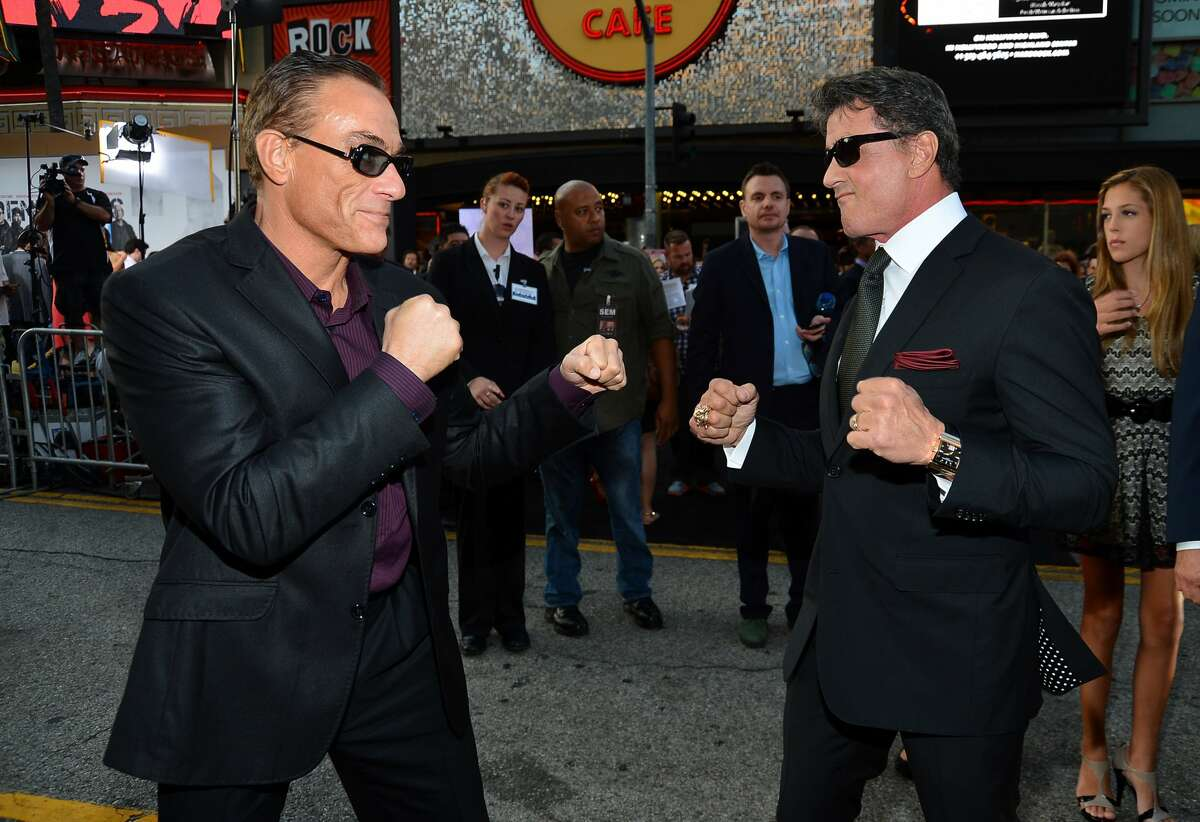 """Actor Jean-Claude Van Damme and actor/writer/director Sylvester Stallone arrive at Lionsgate Films'""""The Expendables 2"""" premiere on August 15, 2012 in Hollywood, California. (Frazer Harrison / Getty Images)"""