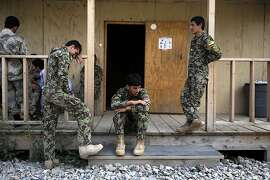TOPSHOTS Soldiers of the Afghan National Army (ANA) wait for their comrades after a training session at the Narizah base in Narizah, Khost Province on August 13, 2012.  Some 130,000 NATO troops in Afghanistan are preparing to withdraw in 2014 and are training and working alongside Afghan soldiers as they take increasing responsibility for the anti-insurgency campaign.  AFP PHOTO/ Jose CABEZASJose CABEZAS/AFP/GettyImages