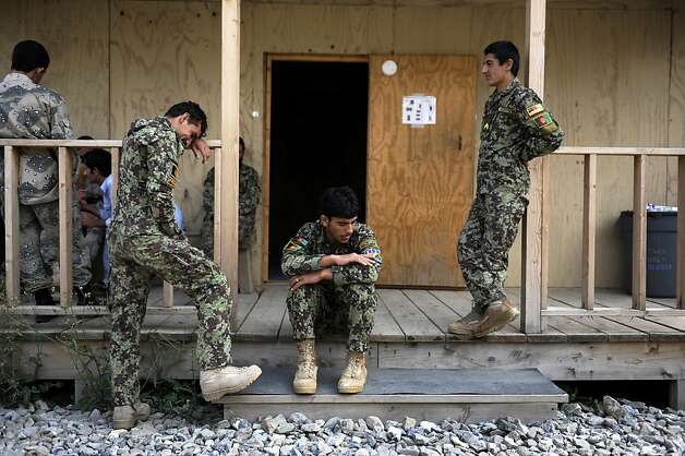 Afghan army soldiers relax after a training session in Khost province. The U.S. military admits none of the Afghan forces are ready to fight on their own. Photo: Jose Cabezas, AFP/Getty Images / SF