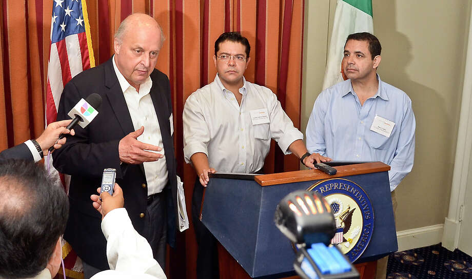 Chairman of the Council of the Americas, John Negroponte, stands with Arnulfo Valdivia-Machuco from the office of Mr. Enrique Pe–a-Nieto and U.S. Representative Henry Cuellar as they participate in a Q&A session with the media, Thursday afternoon at La Posada Hotel.