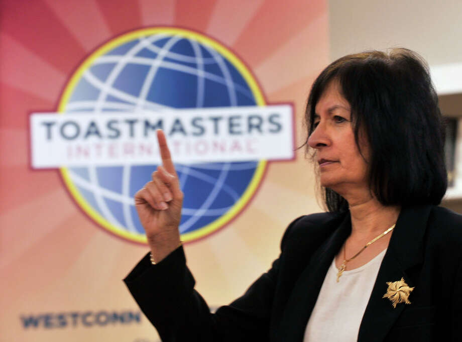 "Bala Krishnamurthy gives her ""ARMS: Asset Relocation Management System"" speech during a WestConn Toastmasters Club meeting at the Wooster School library in Danbury on Thursday, Aug. 16, 2012. Photo: Jason Rearick / The News-Times"