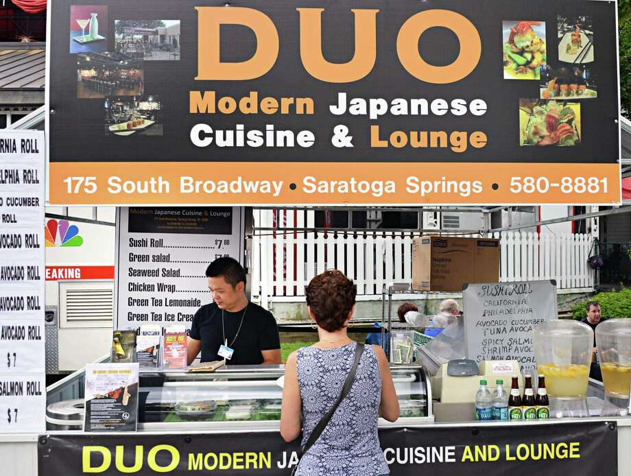 Chef Wilfred Sheng prepares modern Japanese dishes at the Duo stand outside the Clubhouse entrance at Saratoga Race Course Wednesday Aug. 15, 2012. (John Carl D'Annibale / Times Union) Photo: John Carl D'Annibale / 00018831A