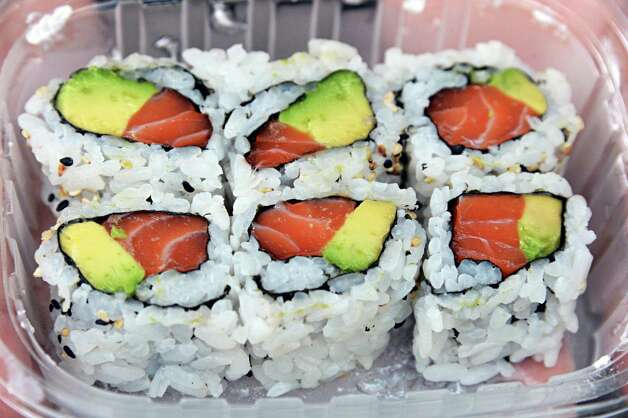 Salmon avocado rolls from the Duo Japanese foods stand outside the Clubhouse entrance at Saratoga Race Course Wednesday Aug. 15, 2012. (John Carl D'Annibale / Times Union) Photo: John Carl D'Annibale / 00018831A