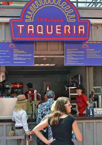 Customers line up at El Verano Tacqueria at The Post at Saratoga Race Course Wednesday Aug. 15, 2012. (John Carl D'Annibale / Times Union) Photo: John Carl D'Annibale / 00018831A