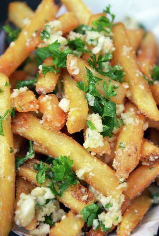 Garlic Frites from Box Frites at The Post at Saratoga Race Course Wednesday Aug. 15, 2012. (John Carl D'Annibale / Times Union) Photo: John Carl D'Annibale / 00018831A