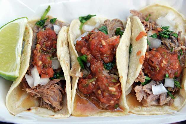 An order of Carnitas from El Verano Tacqueria at The Post at Saratoga Race Course Wednesday Aug. 15, 2012. (John Carl D'Annibale / Times Union) Photo: John Carl D'Annibale / 00018831A