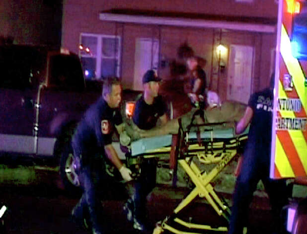 San Antonio EMS paramedics transport a victim from residence on the 300 block of West Norwood. A fire broke out late Wednesday night August 15, 2012. Three men with alleged mental disabilities died in the blaze and another person is in critical condition .Courtesy photo/Henry Valadez, Jr.