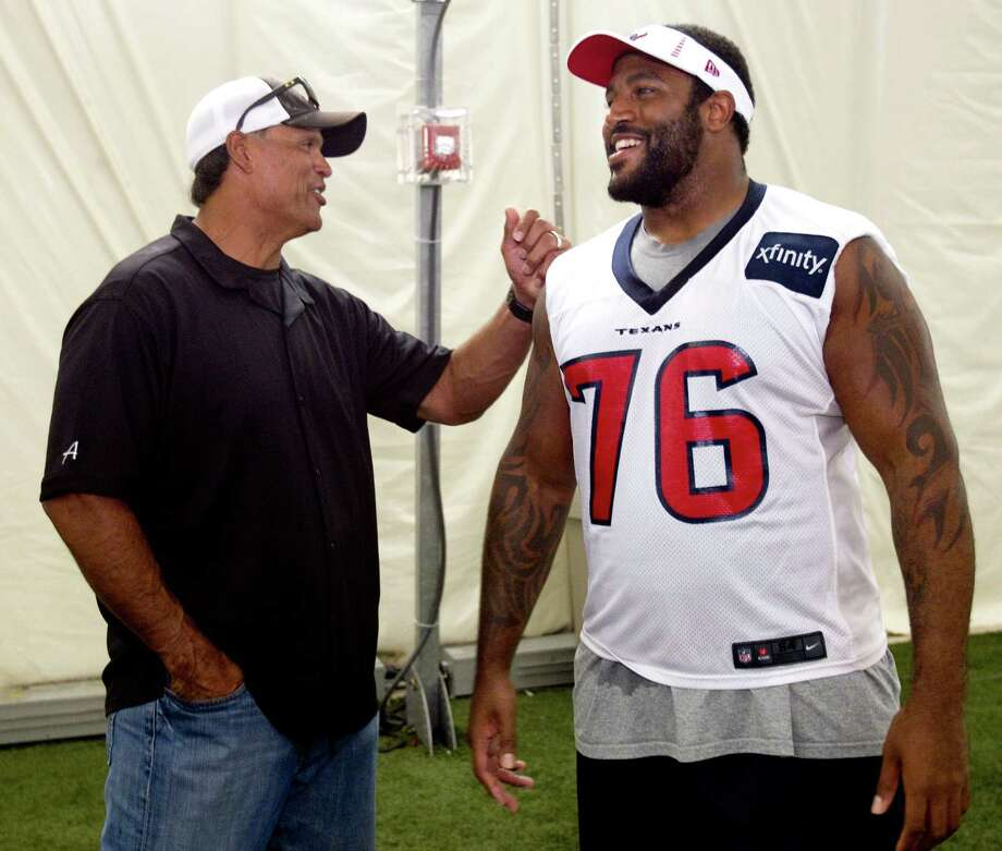 Former Cincinnati Bengals and Pro Football Hall of Fame tackle Anthony Muñoz, left, greets Houston Texans tackle Duane Brown following practice during Texans training camp at the Methodist Training Center Thursday, Aug. 16, 2012, in Houston.  Brown received a contract extension with the Texans on Thursday. Photo: Brett Coomer, Houston Chronicle / © 2012 Houston Chronicle