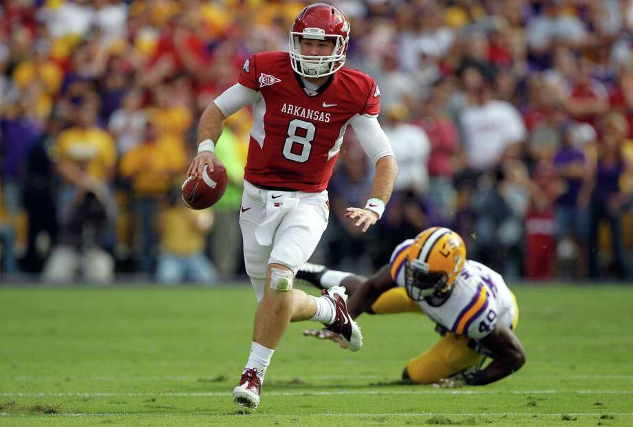 Arkansas quarterback Tyler Wilson avoids a rush by LSU defensive end Barkevious Mingo on Nov. 25, 2011 in Baton Rouge, La. Photo: Chris Graythen, Getty Images / 2011 Getty Images