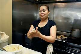 Daytime chef Olivia Perez making tacos and pupusas at cafe and restaurant Montecristo in San Francisco , Calif., on Monday, August  13, 2012.