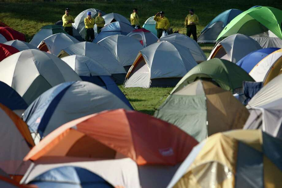 Firefighters camp in a field at Cle Elum-Roslyn School on Thursday, August 16, 2012. The Taylor Bridge Fire has forced hundreds to evacuate and has burned dozens of homes. Photo: JOSHUA TRUJILLO / SEATTLEPI.COM