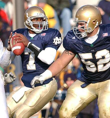 Former Roosevelt standout Carlyle Holliday had an up-and-down career at Notre Dame, but he passed for 2,876 yards with 14 TDs and 16 INTs as a quarterback from 2001-03. He was a receiver as a senior in 2004. In 2002, he passed for 1,788 yards with 10 TDs and five INTs for a 10-3 Irish team that lost to North Carolina State in the Gator Bowl. In 2001, he rushed for 666 yards and passed for 784. He played three seasons in the NFL with the Cardinals and Packers.