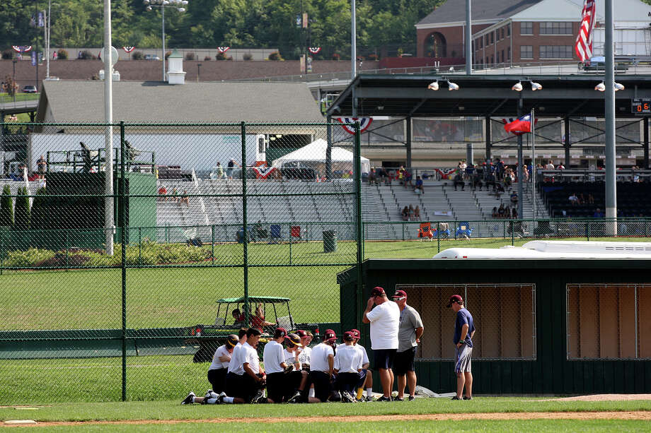 The McAllister Park National LIttle League team gathers as they wrap up practice on the first day of the 2012 Little League World Series in South Williamsport, Pa., Thursday, Aug. 16, 2012. The San Antonio team, representing the Southwest Champions, will face off with the Mid-Atlantic Champions from Parsippany, New Jersey, in their first game Friday afternoon. Photo: Jerry Lara, San Antonio Express-News / © 2012 San Antonio Express-News
