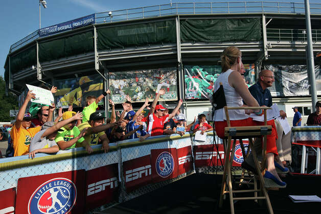 Players, fans and family gather by the ESPN broadcast area for an opportunity to be on live television on the first day of the 2012 Little League World Series in South Williamsport, Pa., Thursday, Aug. 16, 2012. San Antonio's McAllister Park National Little League team, representing the Southwest Champions, will face off with the Mid-Atlantic Champions from Parsippany, New Jersey, Friday afternoon. Photo: Jerry Lara, San Antonio Express-News / © 2012 San Antonio Express-News