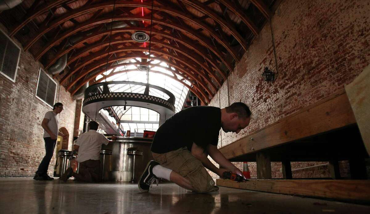 Scott Walcott works on demo-ing the band stand in the space at 924 Congress, The former Red Cat Jazz Cafe,Wednesday, Aug. 8, 2012, in Houston, as they prepare to open a non-profit saloon in downtown Houston, scheduled to open in about four months. ( Karen Warren / Houston Chronicle )