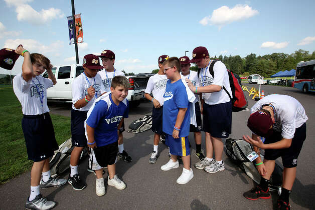 The McAllister Park National Little League team sign autographs after wrapping up practice on the first day of the 2012 Little League World Series in South Williamsport, Pa., Thursday, Aug. 16, 2012. The team, representing the Southwest Champions will face off with the Mid-Atlantic Champions from Parsippany, New Jersey, Friday afternoon. Getting their tee-shirts signed are Rocco Frisco, 10, left, and Derek Timko, 11. Photo: Jerry Lara, San Antonio Express-News / © 2012 San Antonio Express-News