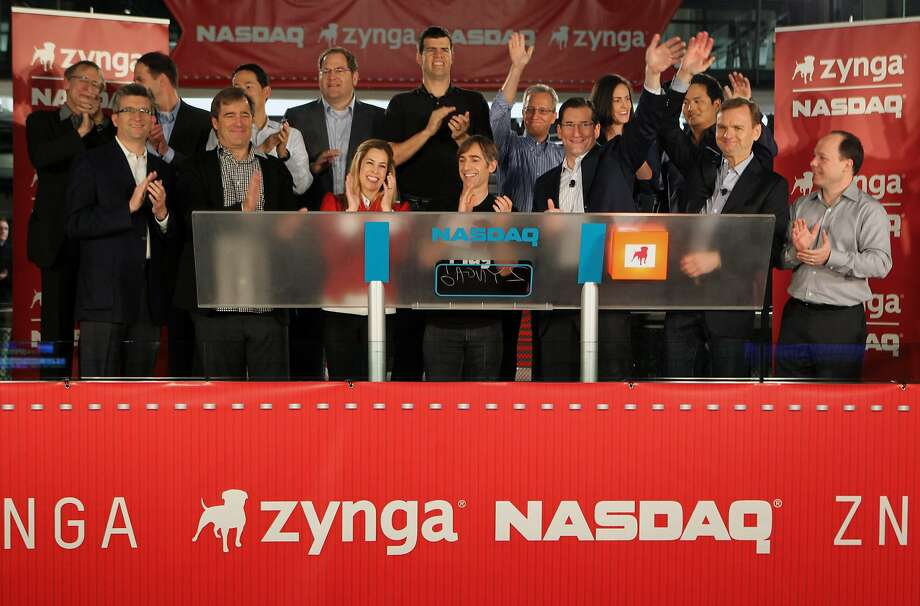 Mark Pincus, chief executive officer of Zynga Inc., center, is joined by Bing Gordon, Zynga board member, second from left in front row, wife Alison Pincus, third from left, and Robert Greifeld, chief executive officer of Nasdaq OMX Group Inc., third from right, as he rings the Nasdaq MarketSite opening bell remotely from Zynga headquarters in San Francisco, California, U.S., on Friday, Dec. 15, 2011. Zynga Inc., the largest maker of games for Facebook Inc.'s website, raised $1 billion in its initial public offering, pricing the shares at the top of the marketed range. Photographer: Zef Nikolla/Nasdaq Mark Pincus, chief executive officer of Zynga Inc., center, is joined by Bing Gordon, Zynga board member, second from left in front row, wife Alison Pincus, third from left, and Robert Greifeld, chief executive officer of Nasdaq OMX Group Inc., third from right, as he rings the Nasdaq MarketSite opening bell remotely from Zynga headquarters in San Francisco, California, U.S., on Friday, Dec. 15, 2011. Zynga Inc., the largest maker of games for Facebook Inc.'s website, raised $1 billion in its initial public offering, pricing the shares at the top of the marketed range. Photographer: Zef Nikolla/Nasdaq via Bloomberg  EDITOR'S NOTE: EDITORIAL USE ONLY. NO SALES. Photo: Zef Nikolla, Nasdaq