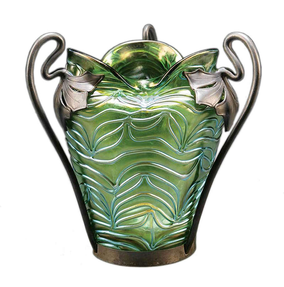 The pewter mounting with the mark of the Van Houten company helps identify this iridescent glass vase. Loetz and Kralik both used Van Houten pewter after 1890. Neal Auctionís experts in New Orleans could say only that the 7 1/2-inch-high vase was ìContinental.î Because of its quality, it auctioned for $854. Photo: Contributed Photo