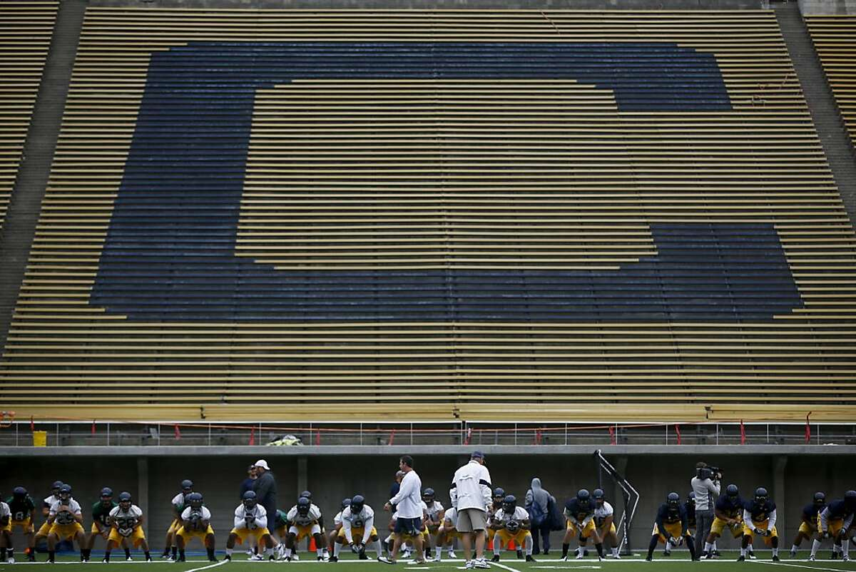 Members of the California Golden Bears football team stretch during the team's first practice at the newly renovated Memorial Stadium in Berkeley, Calif. on Thursday, Aug. 16, 2012.