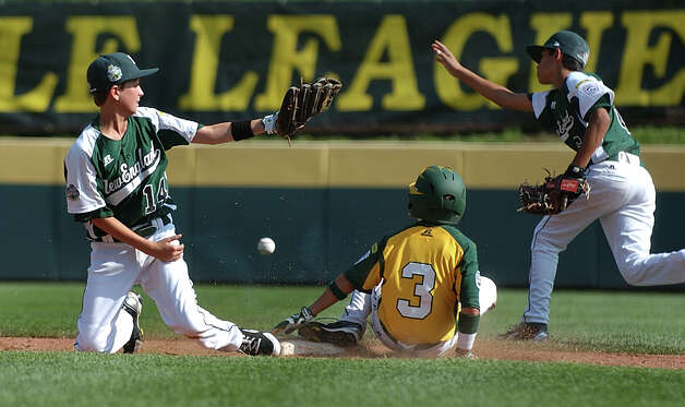 New England's #14 Chris Meyers, left, misses the tag out on West's #3 Austin Paretti as he slides into second, during 2012 Little League World Series game action in South Williamsport, Penn. on Thursday August 16, 2012. Photo: Christian Abraham / Connecticut Post