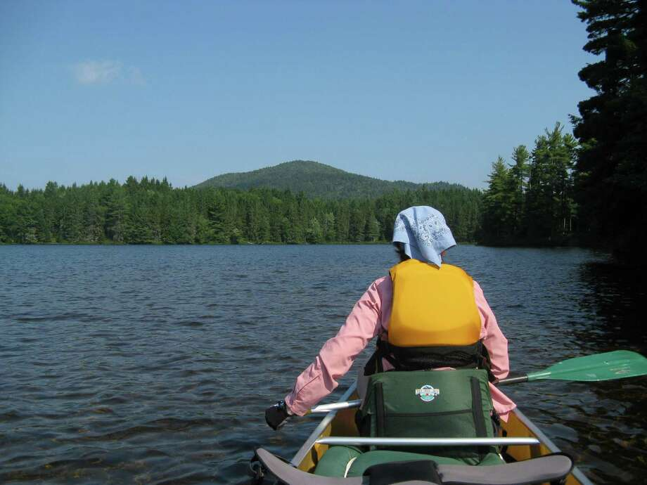 Photo by Herb Terns. Gillian looks across Long Pond to Long Pond Mountain in the St. Regis Canoe Area. Photo: Picasa